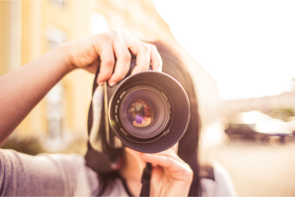 Woman pointing a camera